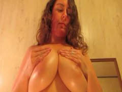 Large boobed older gives cook jerking