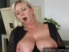 Mature with big love melons and shaved twat