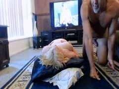Mommy getting drilled on the living room floor